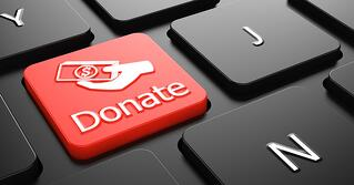 Donate with Money in the Hand Icon - Red Button on Black Computer Keyboard.