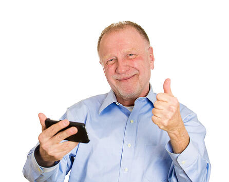 Man looking happy on iphone